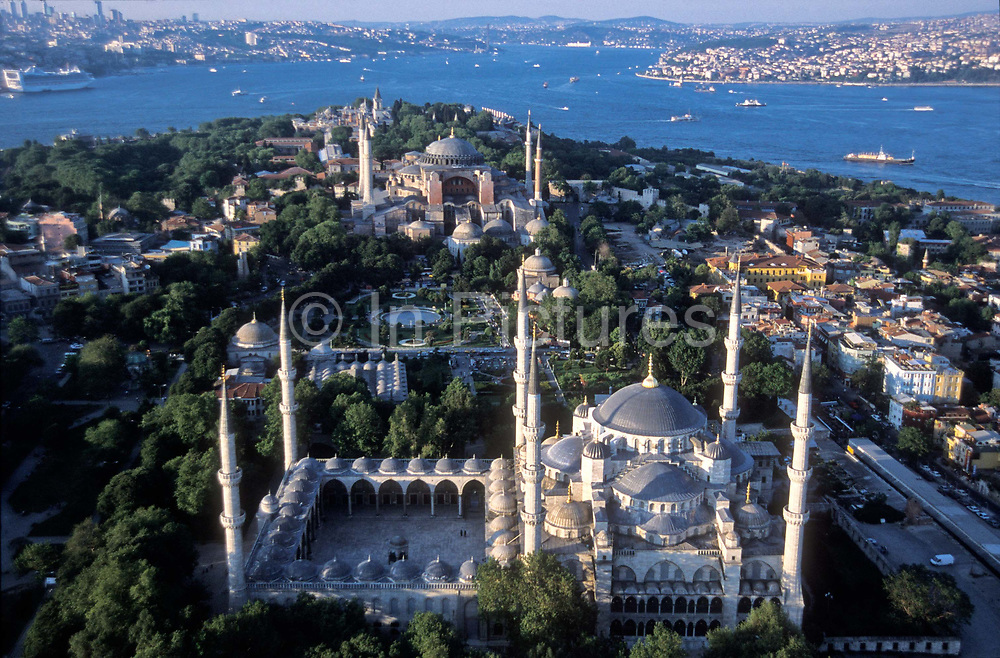 Aerial view of Istanbul city scape, with the Blue Mosque ( built AD:1609-1616) in the foreground and thr Hagia Sophie (built AD 537) in the background with a clear view of the Bosphorous river which divides Asia from Europe, Turkey