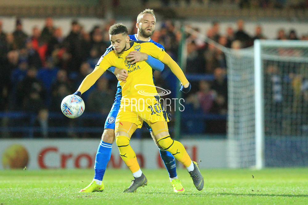 Ryan McLaughlin holds onto Marcus Browne during the EFL Sky Bet League 1 match between Rochdale and Oxford United at Spotland, Rochdale, England on 12 March 2019.