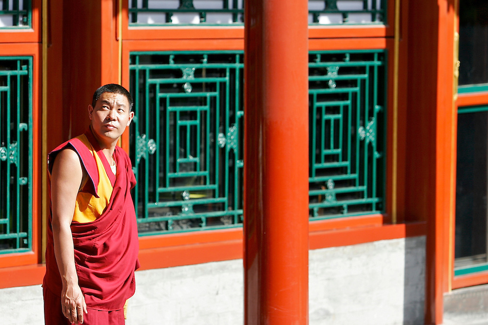 A monk pauses and looks up at the Tower of Buddhist Incense a structure inside the Summer Palace.  The Summer Palace in north west Beijing was built in the Jin Dynasty.  The Summer Palace is over 700 acres, 3/4 of which is the Kunming Lake.
