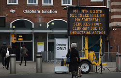 CAPTION CORRECTION © Licensed to London News Pictures. 19/12/2016. London, UK. A sign announces that there will be no Southern services at Clapham Junction - although some Southern Rail trains were seen running today at the station. ASLEF union drivers have started a two day strike in a dispute over driver-only operated trains. Photo credit: Peter Macdiarmid/LNP