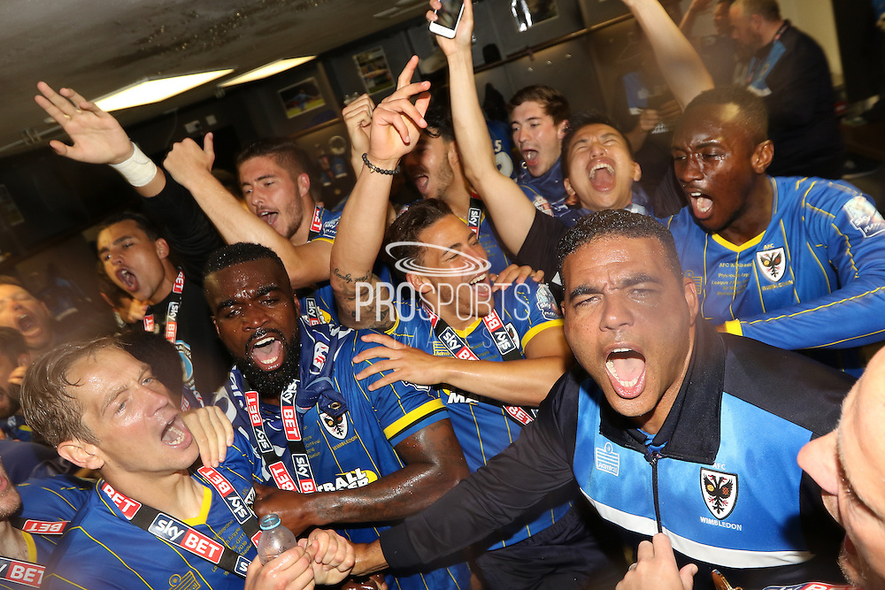 Players celebrate in the dressing room at Wembley. AFC Wimbledon promotion to League One, after beating Plymouth Argyle Football Club 2-0 during the Sky Bet League 2 play off final match between AFC Wimbledon and Plymouth Argyle at Wembley Stadium, London, England on 30 May 2016. Photo by Stuart Butcher.