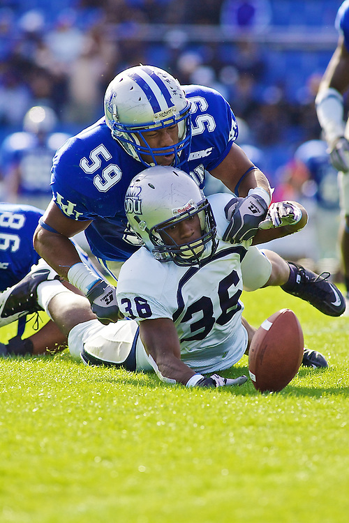 Oct 30, 2010; Hampton VA, USA; Old Dominion running back Colby Goodwyn (36) and Hampton Pirates linebacker Darius Johnson (59) dive for a fumble in the first half at Armstrong Stadium. The Monarchs won 28-14. Mandatory Credit: Peter J. Casey