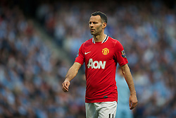 MANCHESTER, ENGLAND - Monday, April 30, 2012: Manchester United's Ryan Giggs in action against Manchester City during the Premiership match at the City of Manchester Stadium. (Pic by David Rawcliffe/Propaganda)
