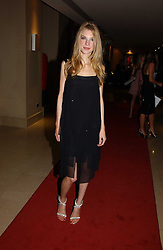 JESSICA WELLS at a party to launch Three's A Crowd held at the Mayfair Hotel, Berkley Street, London on 5th December 2006.<br />