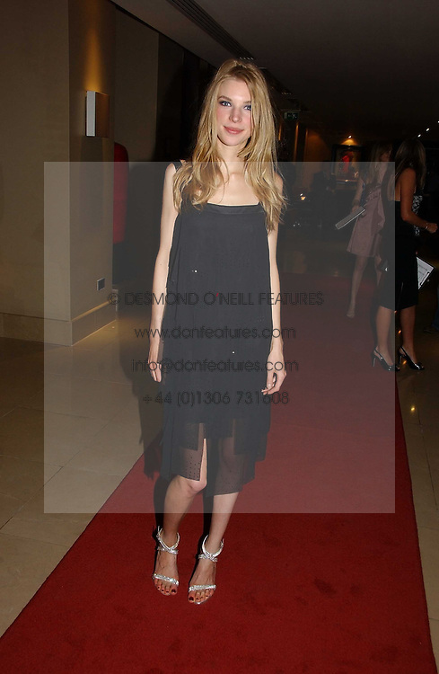 JESSICA WELLS at a party to launch Three's A Crowd held at the Mayfair Hotel, Berkley Street, London on 5th December 2006.<br /><br />NON EXCLUSIVE - WORLD RIGHTS