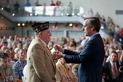06 June 2014. The National WWII Museum, New Orleans, Lousiana. <br /> WWII veteran Randolph Olano, 3rd Armord Division is honored with the French Legion of Honor medal by French Consul General, Claude Brunet..<br /> Photo; Charlie Varley/varleypix.com