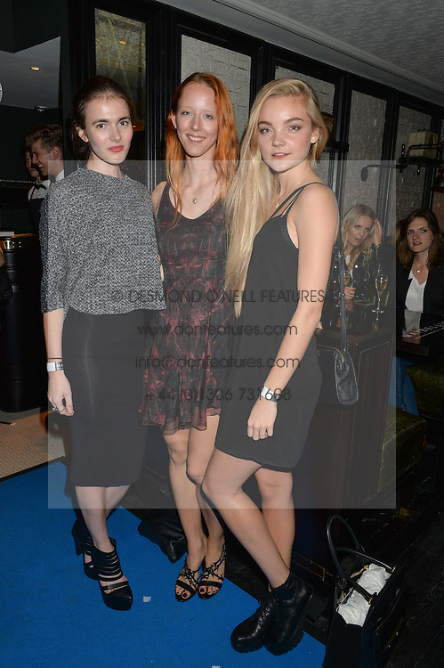 Left to right, LAURA KELL, MORWENNA LYTTON COBBOLD and AMALIE KARDOUB at the Maybelline New York: Party, part of the London Fashion Week Spring Summer 15 held at Tredwell's, 4a Upper St Martins Lane, London on 12th September 2014.