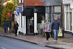 © Licensed to London News Pictures. 17/12/2020. Great Bookham, UK. Shoppers are seen in Great Bookham in central Surrey. All of Surrey, except Waverley, will move from tier 2 to tier 3 restrictions on Saturday as Covid-19 cases rise. Photo credit: Peter Macdiarmid/LNP