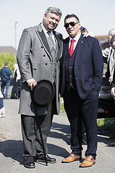 © Licensed to London News Pictures. 21/04/2018. Cobham, UK. Paddy Doherty , here with funeral director Paul Brown, attends the funeral of his mother traveller 'Queenie, Elizabeth Doherty at Sacred Heart Church in Cobham, Surrey. Elizabeth Doherty, whose son Paddy Doherty is known for appearing on My Big Fat Gypsy Wedding and winning Celebrity Big Brother 8, died of a heart attack earlier this month. Paddy Doherty claimed his mother has died of a 'broken heart' following the death of her husband almost a year ago. Photo credit: Peter Macdiarmid/LNP