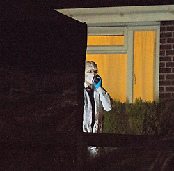 ©Licensed to London News Pictures 22/12/2019. <br /> Crawley Down ,UK.  Police forensic officer at the murder scene tonight. Two people are dead and a third is fighting for life after a knife attack on a housing estate in Crawley Down, West Sussex Photo credit: Grant Falvey/LNP
