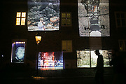 Clement Briand projects work by local artists and the British artist duo kennardphillipps on the walls of Landskronas Museum using analogue slides and home made mobile projectors as part of Landskrona Photo Festival in Landskrona,Sweden, 20th of August 2016.  Clement Briand is an artist working with analogue projections and local communities