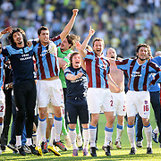 Trabzonspor's players (Left to Right) Rigobert Song BAHANAG, Sezer BADUR, Ceyhun Gulselam, Remzi Giray KACAR, Egemen KORKMAZ, Engin BAYTAR celebrate victory during their Turkey Cup final match Trabzonspor between Fenerbahce at the GAP Arena Stadium at Urfa Turkey on wednesday, 05 May 2010. Photo by TURKPIX