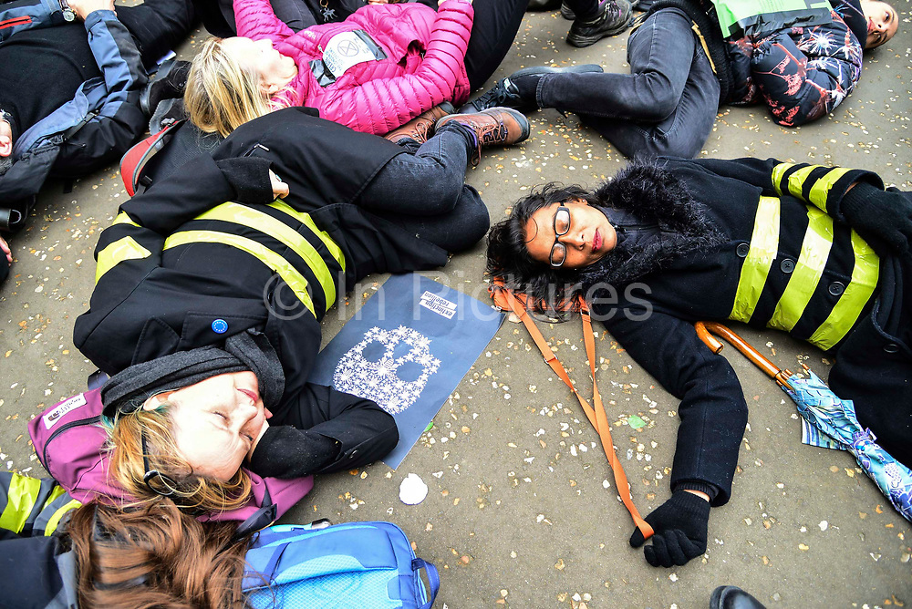 Cyclists from Extinction Rebellion  stage a die in demonstration at Tate Modern called XR Critical Swarm on 27th April 2019 in London, England, United Kingdom. The action aims to highlight the global decline in the bee population and the sudden eradication of bee colonies known as Colony Collapse disorder. The climate change activist group are targeting the Tate who they claim, built their fortune on sugar cane production from colonial exploitation of enslaved Africans, European invasion and exploitation of land in West Indies and South America.
