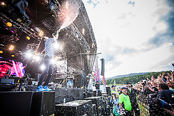 "Steve Aoki showers the stage in champagne, playing the main stage, Saturday at Rockness 2013, the annual music festival which took place in Scotland at Clune Farm, Dores, on the banks of Loch Ness, near Inverness in the Scottish Highlands. The festival is known as ""the most beautiful festival in the world"" ."
