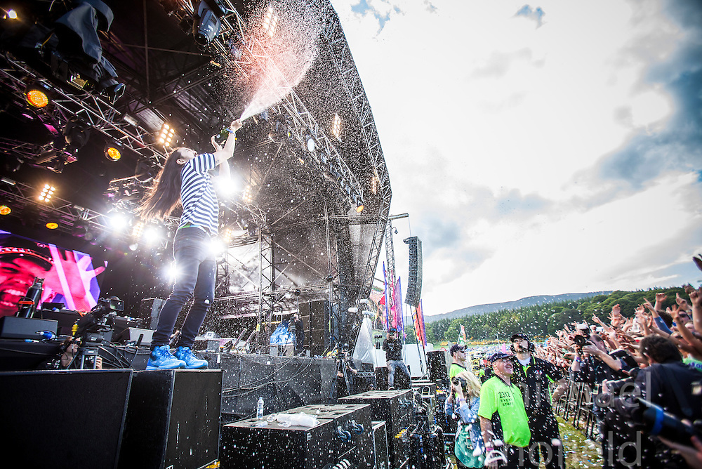 """Steve Aoki showers the stage in champagne, playing the main stage, Saturday at Rockness 2013, the annual music festival which took place in Scotland at Clune Farm, Dores, on the banks of Loch Ness, near Inverness in the Scottish Highlands. The festival is known as """"the most beautiful festival in the world"""" ."""