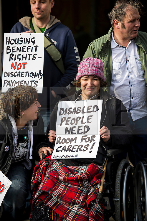 © Licensed to London News Pictures. 29/02/2016. London, UK.  Campaigner CLAIRE GASMAN (centre in wheelchair) joins other Campaigner outside the Supreme Court in London where Justices are due to hear appeals against the under occupancy subsidy, also known as the bedroom tax.  Campaigners believe the reduction in benefits for people in a housing association property that has one or more spare bedrooms, is having a devastating impact on vulnerable people.  Photo credit: Ben Cawthra/LNP