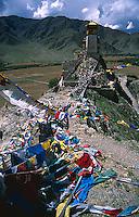 Prayer flags draped across to Yambulakhang monastery, Tibet.