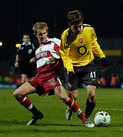 Photo: Jed Wee.<br /> Doncaster Rovers v Arsenal. Carling Cup. 21/12/2005.<br /> <br /> Arsenal's Arturo Lupoli (R) is tackled by Doncaster's James Coppinger.