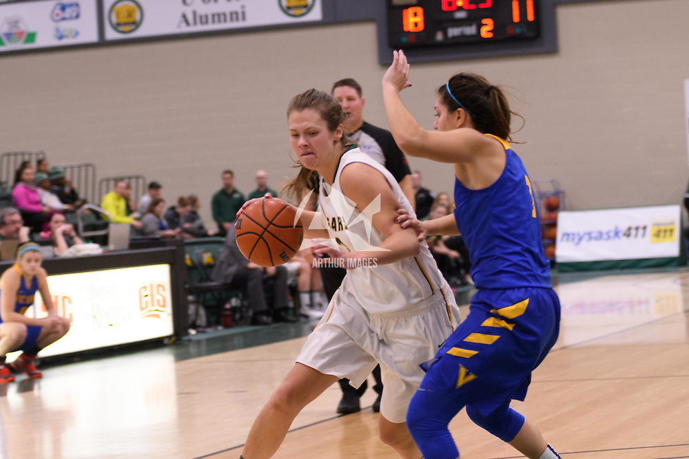 5th year guard Katie Polischuk (3) of the Regina Cougars in action during the home opener  on November  4 at Centre for Kinesiology, Health and Sport. Credit: /Arthur Images