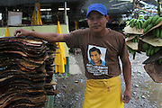 Juan Gustavino, Ngäbe member of COOBANA, removes and washes the protectors that divide recently harvested banana clusters. Mr. Gustavino is wearing a T-Shirt that commemorates former COOBANA member Antonio Smith, killed by State Police forces in July, 2010, as banana syndicates demanded the cancellation of controversial law 30. COOBANA, Finca 51, Changuinola, Bocas del Toro, Panamá. September 3, 2012.