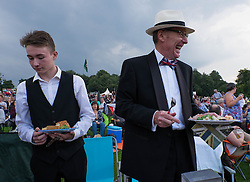 © Licensed to London News Pictures.22/08/15<br /> Castle Howard, North Yorkshire, UK. <br /> <br /> Friends enjoy a picnic as they join hundreds of other people attending the 25th anniversary of the Castle Howard Proms event near York. The theme of the event this year is a commemoration of the 75th anniversary of the Battle of Britain and the 70th anniversary of VE day and brings an evening of classic musical favourites celebrating Britishness to the lawns of Castle Howard.<br /> <br /> Photo credit : Ian Forsyth/LNP