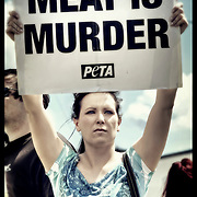 """People for the Ethical Treatment of Animals (PETA) stage a """"Meat is Murder"""" protest in front of Cargill Meat Solutions Inc. on Canal Street in Milwaukee, WI. Photo © 2011 Jennifer Rondinelli Reilly. All Rights Reserved. NO USE WITHOUT PERMISSION."""