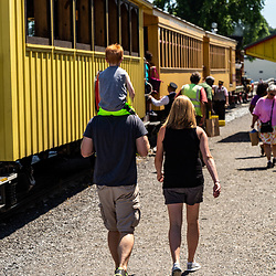 New Freedom, PA – June 25, 2016: Passengers climb aboard a train car in New Freedom.