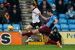 Luke Freeman of Bristol City is challenged by Miguel Angel Llera of Scunthorpe United - Photo mandatory by-line: Rogan Thomson/JMP - 07966 386802 - 17/01/2015 - SPORT - FOOTBALL - Scunthorpe, England - Glanford Park - Scunthorpe United v Bristol City - Sky Bet League 1.