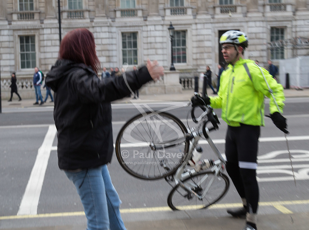 PLACE, January 14 2018. A few dozen protesters from 'The People's Charter' group demonstrate outside Downing Street demanding that the Brexit referendum result is respected following calls for a second referendum. PICTURED: A cyclist who repeatedly rode past the demonstration flying the EU flag just after his flag was stolen from him by protesters. © Paul Davey