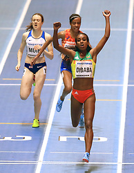 Ethiopia's Genzebe Dibaba celebrates winning the Women's 3000m final during day one of the 2018 IAAF Indoor World Championships at The Arena Birmingham, Birmingham.