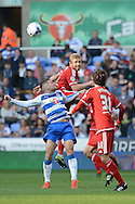 Middlesbrough midfielder Adam Clayton beats Reading midfielder Oliver Norwood to the ball during the Sky Bet Championship match between Reading and Middlesbrough at the Madejski Stadium, Reading, England on 3 October 2015. Photo by Alan Franklin.