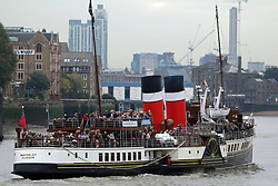 "© Licensed to London News Pictures. 27/09/2014. It's the first morning of the paddlesteamer Waverley's annual season on the Thames in London. The famous vessel from Scotland was built on the Clyde in 1947 and is the world's last sea going Paddle Steamer. The Waverley went ""doon the watter"" this morning, passing under iconic Tower Bridge at 9.20am.  She will remain on the Thames until mid October. Credit : Rob Powell/LNP"