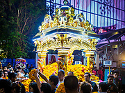 30 SEPTEMBER 2017 - BANGKOK, THAILAND:  People surround the chariot bearing the deity and try to leave offerings on it during the Navratri parade in Bangkok. Navratri is a nine night (10 day) long Hindu celebration that marks the end of the monsoon and honors of the divine feminine Devi (Durga). The festival is celebrated differently in different parts of India, but the common theme is the battle and victory of Good over Evil based on a regionally famous epic or legend such as the Ramayana or the Devi Mahatmya. Navratri is celebrated throughout Southeast Asia in communities that have large Hindu population. Bangkok's celebration of Navratri was subdued this year because Thais are still mourning the death of Bhumibol Adulyadej, the Late King of Thailand, who died on October 13, 2016.     PHOTO BY JACK KURTZ