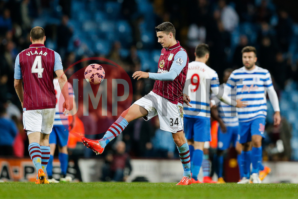 Matthew Lowton of Aston Villa kicks the ball away in frustration after the match ends in a 3-3 draw - Photo mandatory by-line: Rogan Thomson/JMP - 07966 386802 - 07/04/2015 - SPORT - FOOTBALL - Birmingham, England - Villa Park - Aston Villa v Queens Park Rangers - Barclays Premier League.