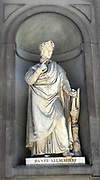 Statue located outside of the Uffizi museum in Florence, Italy. One of the oldest art museums in the Western World. Semi enclosed figurative statues such as this appear all over Florence. Statue of poet and writer Dante Alslighieri.