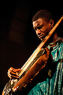Bassekou Kouyate and his band Ngoni ba performing live at Union Chapel in Islington, London, UK (20 March 2014). Pictured here, Bassekou's son Moustafa Kouyate.