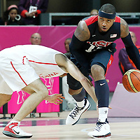 31 July 2012: USA Carmelo Anthony steals the ball during 110-63 Team USA victory over Team Tunisia, during the men's basketball preliminary, at the Basketball Arena, in London, Great Britain.