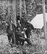 Seated, is Winfield Scott Hancock; the boy-general, Francis C. Barlow (who was struck almost mortally), leans against the tree. The other two are General John Gibbon and General David B. Birney. from the book ' The Civil war through the camera ' hundreds of vivid photographs actually taken in Civil war times, sixteen reproductions in color of famous war paintings. The new text history by Henry W. Elson. A. complete illustrated history of the Civil war
