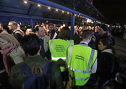 People queue outside London City Airport which has reopened after dozens of passengers were treated for breathing difficulties after a suspected chemical incident at the airport.