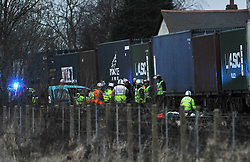 © Licensed to London News Pictures. 2/1/2013. Emergency services covering the body (right) and wreckage of a car (left)  at the scene where a man died when his car is hit by a freight train on a level crossing  on Sandy Lane between Yarnton and Kidlington in Oxfordshire. The man was declared dead at the scene. Photo credit: MarkHemsworth/LNP