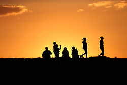 © Licensed to London News Pictures. 04/06/2021. Huddersfield, UK.  People watch a glorious sunset from Castle Hill in Huddersfield on Friday evening. The current spell of fine weather is set to continue over the weekend and into next week. Photo credit: Adam Vaughan/LNP