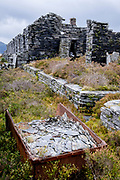 Derelict building ruins stand on Welsh a mountain top, a century after it was part of the slate industry, on 5th October 2021, in Blaenau Ffestiniog, Gwynedd, Wales. The derelict slate mines around Blaenau Ffestiniog in north Wales were awarded UNESCO World Heritage status in 2021. The industry's heyday was the 1890s when the Welsh slate industry employed approximately 17,000 workers, producing almost 500,000 tonnes of slate a year, around a third of all roofing slate used in the world in the late 19th century. Only 10% of slate was ever of good enough quality and the surrounding mountains now have slate waste and the ruined remains of machinery, workshops and shelters have changed the landscape for square miles.