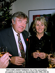 MR & MRS JIMMY TARBUCK, he is the comedian,  at a party in London on November 6th 1996.LTH 33.