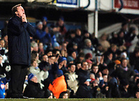 Photo: Daniel Hambury.<br />Portsmouth v Liverpool. The FA Cup. 29/01/2006.<br />Portsmouth's manager Harry Redknapp looks to the sky as his side crash out of the FA Cup.
