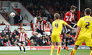 Brentford midfielder Alan Judge heads to put Brentford back in the lead during the Sky Bet Championship match between Brentford and Rotherham United at Griffin Park, London, England on 17 October 2015. Photo by Andy Walter.