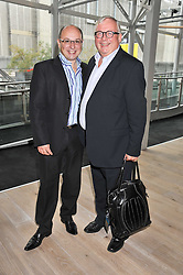 Left to right, NEIL SINCLAIR nd CHRISTOPHER BIGGINS at a party to celebrate the publication of her  autobiography - The World According to Joan, held at the British Film Institute, South Bank, London SE1 on 8th September 2011.