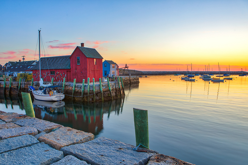New England harbor scenery photography of Motif Number One and sail boat reflection during sunrise twilight and dawn at Rockport Harbor on Cape Ann, MA.<br /> <br /> Cape Ann New England harbor scenery photography image artworks are available as museum quality photography prints, canvas prints, acrylic prints, wood prints or metal prints. Prints may be framed and matted to the individual liking and decorating needs.<br /> <br /> Good light and happy photo making!<br /> <br /> My best,<br /> <br /> Juergen