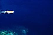Looking down on small open boat in deep blue sea, island of Ibiza, Balearic Islands, Spain, 1950s