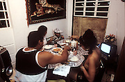 (MODEL RELEASED IMAGE). Dinner at the Costa home. (Supporting image from the project Hungry Planet: What the World Eats.) The Costa family of Havana, Cuba, is one of the thirty families featured, with a weeks' worth of food, in the book Hungry Planet: What the World Eats.