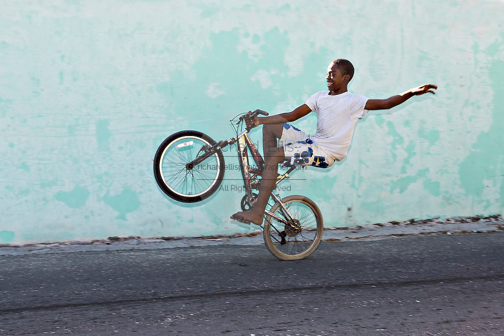 Bahamian boy rides his bicycle in Dunmore Town, Harbour Island, The Bahamas